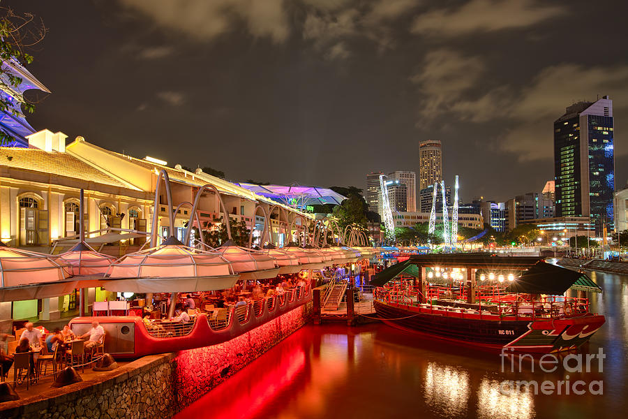 Clarke Quay Photograph - Chasing The Light At Clarke Quay by Pete Reynolds