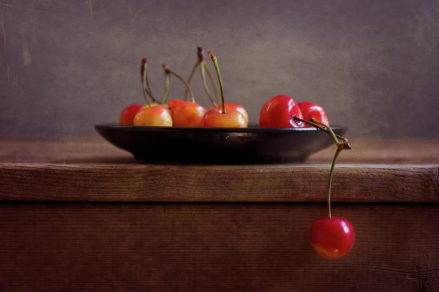 Cherries On Black Plate Photograph by Copyright Anna Nemoy(xaomena)