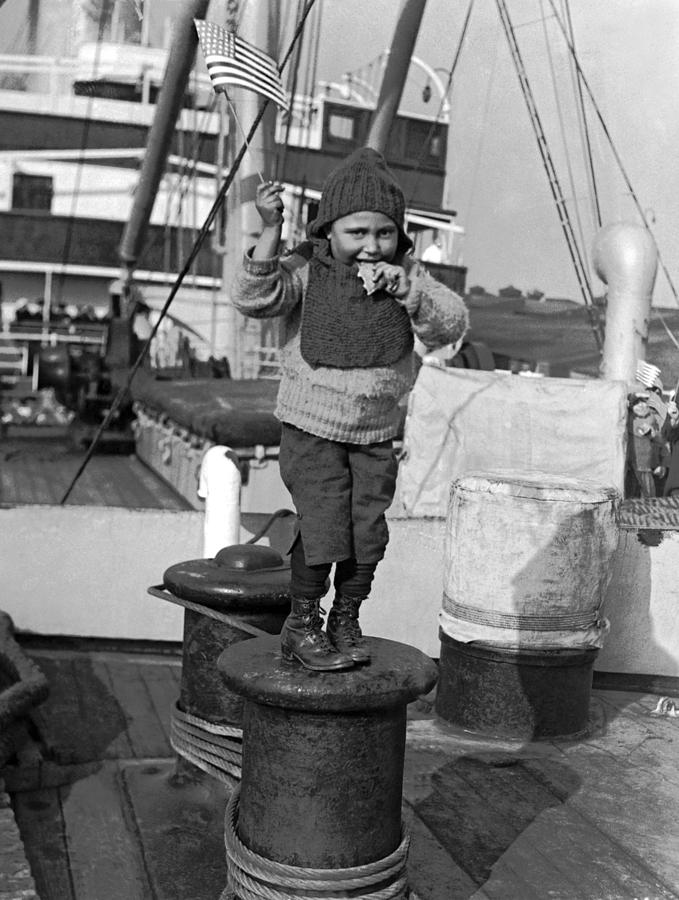 1926 Photograph - Child Arriving At Ellis Island by Underwood Archives