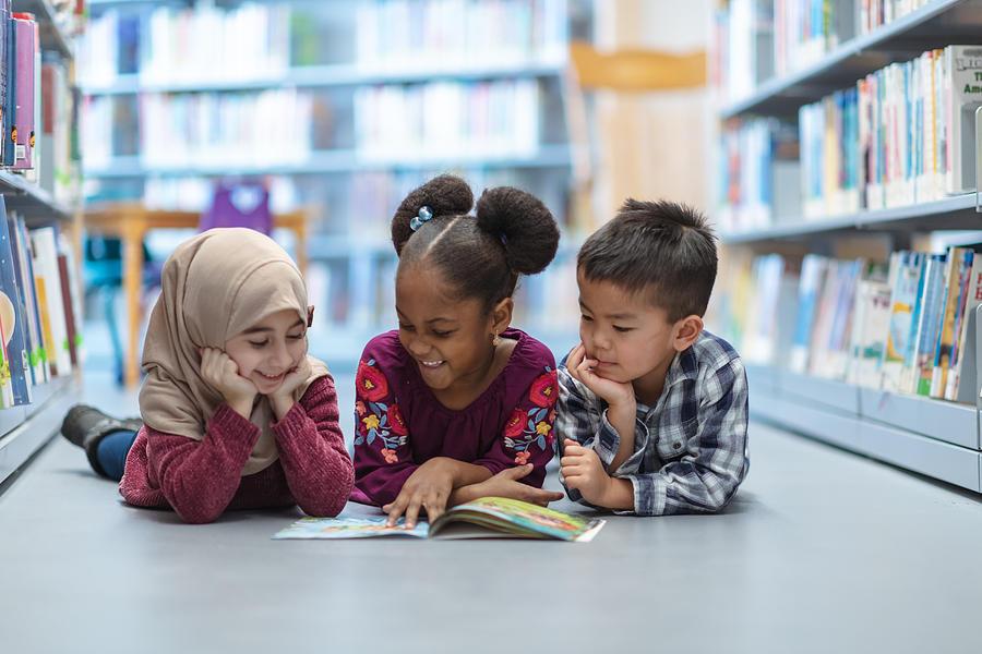 Children Reading Photograph by FatCamera