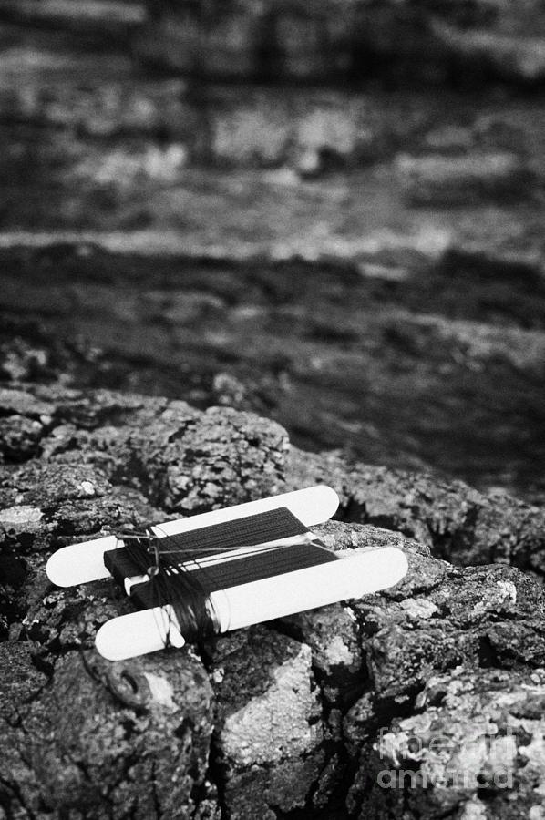 Northern Photograph - Childrens Bright Orange Crab Line Fishing Line Sitting On Rocks With Rock Pools by Joe Fox