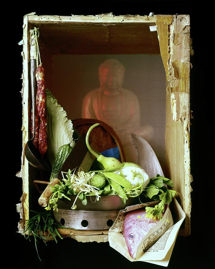 Chinese Statue With Cooking Items Photograph by Fotiades