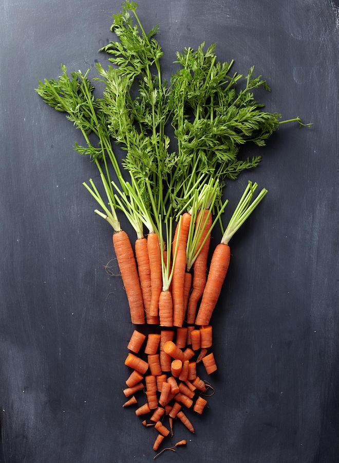 Chopped Carrot Bunch Photograph by Shana Novak