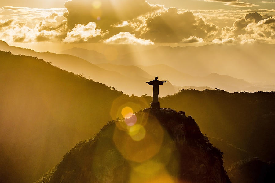 Christ The Redeemer Seen From Above At Sunset Photograph by Bambu Productions