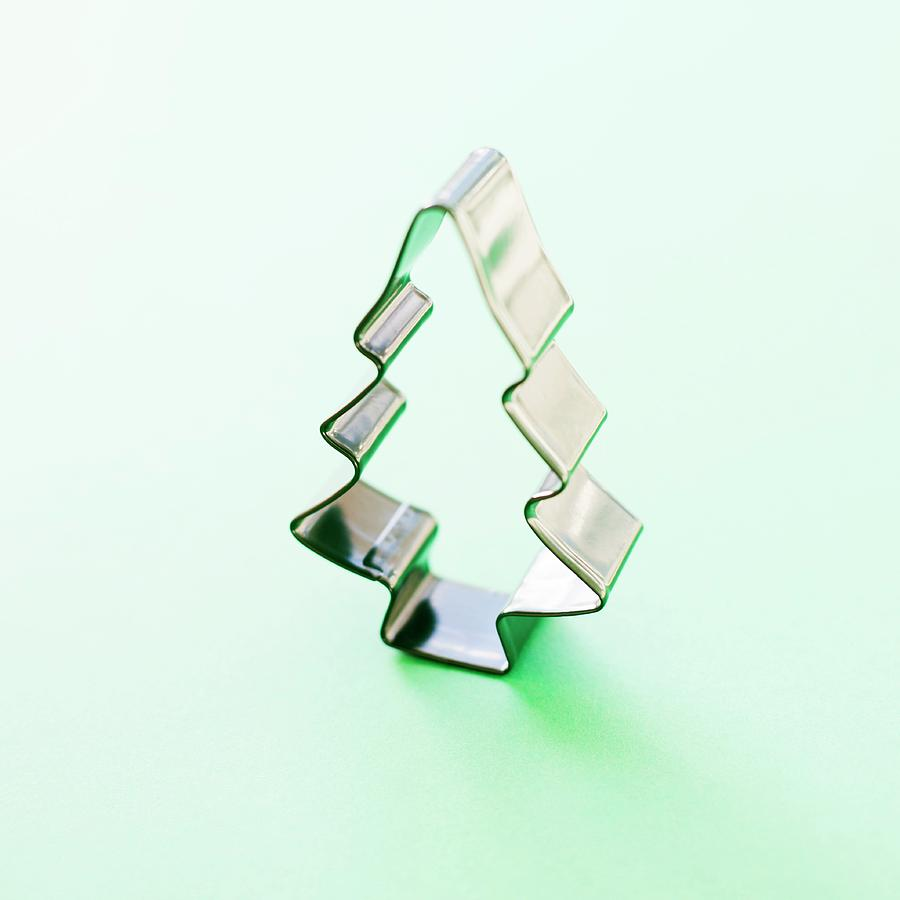 artwork photograph christmas tree cookie cutter by ian hootonscience photo library