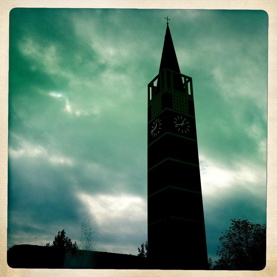 Church Photograph - Church steeple and dark cloudy sky by Matthias Hauser