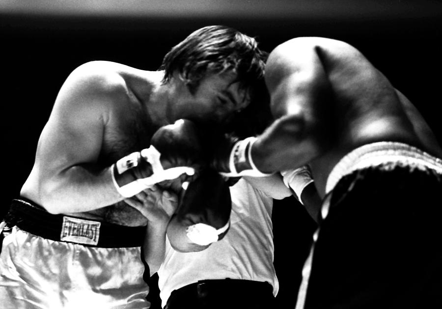 Chuvalo In A Clinch Photograph by Robert  Rodvik