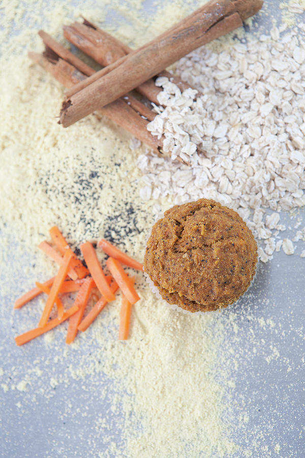 Cinnamon, Grains, Nuts And Carrots Photograph by Laurie Castelli