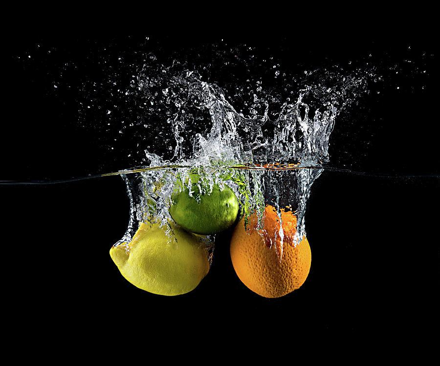 Splash Photograph - Citrus Splash by Mogyorosi Stefan