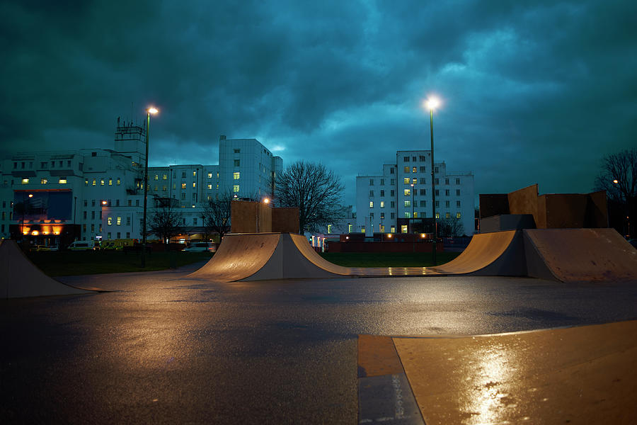Cityscape And Skateboard Park At Night Photograph by Peter Muller