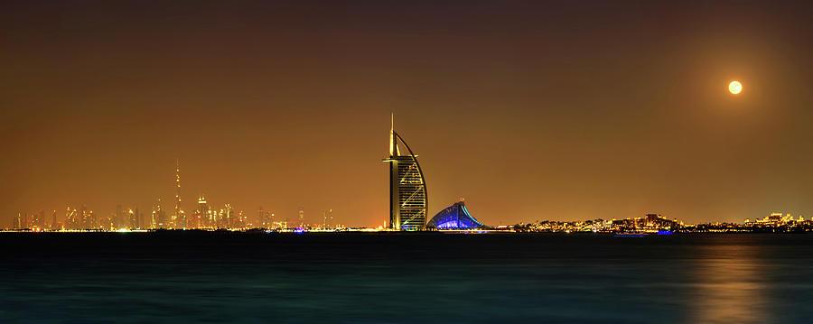 Horizontal Photograph - Cityscape At Night, Burj Al Arab Hotel by Panoramic Images