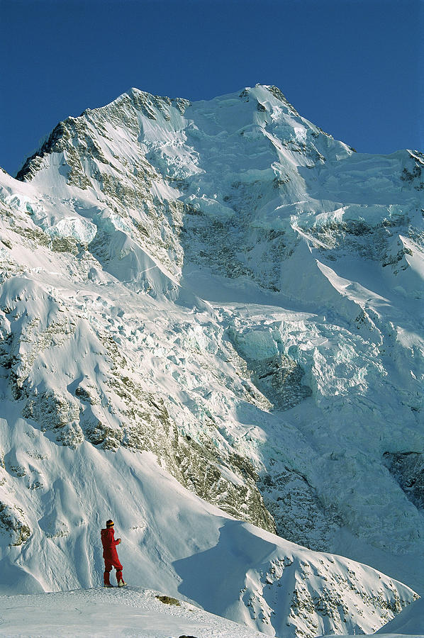 Climber Enjoying View Of Mt Cook Photograph by Colin Monteath