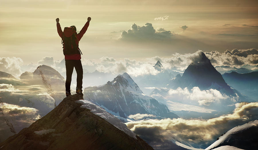 Climber Standing On A Mountain Summit Photograph by Buena Vista Images