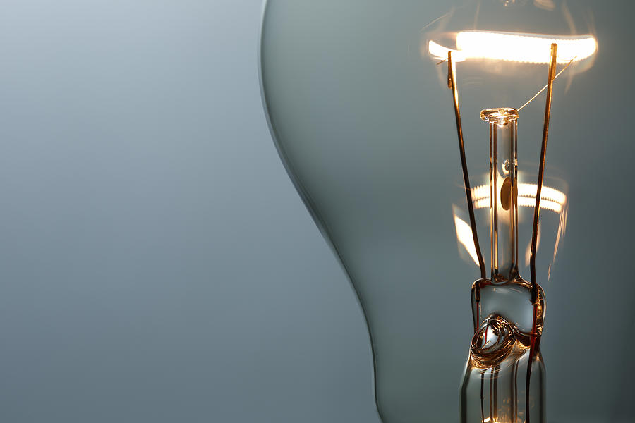 Close Up Glowing Light Bulb Photograph by Bernie_photo