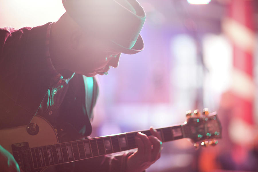 Close Up Mature Man Playing Guitar On Photograph by Zero Creatives