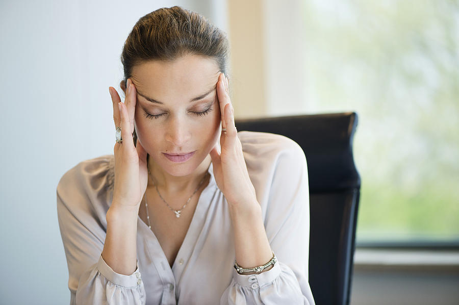 Close-up of a businesswoman suffering from a headache in an office Photograph by ONOKY - Eric Audras