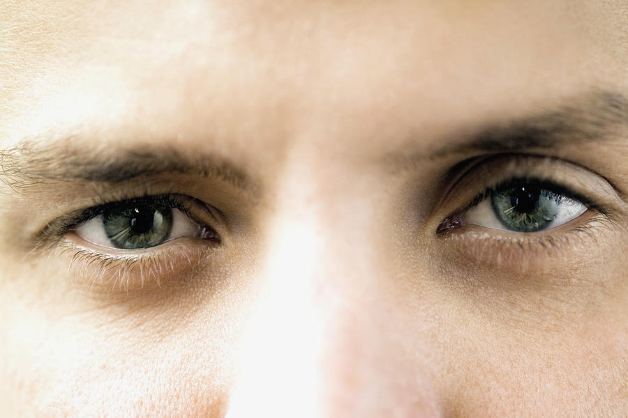 Close-up of a young mans eyes Photograph by Medioimages/Photodisc