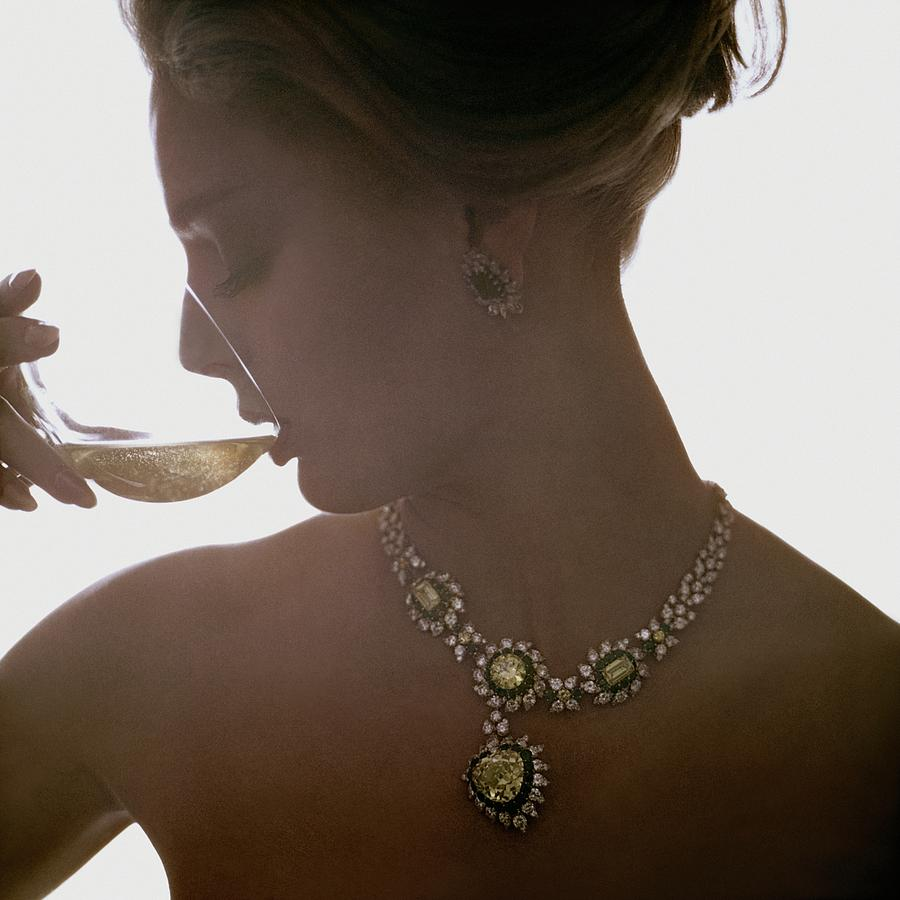 Close Up Of A Young Woman Wearing Jewelry Photograph by Bert Stern