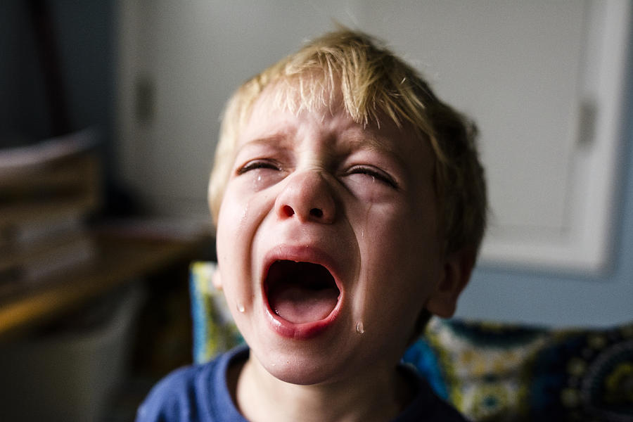 Close-up of boy crying at home Photograph by Cavan Images