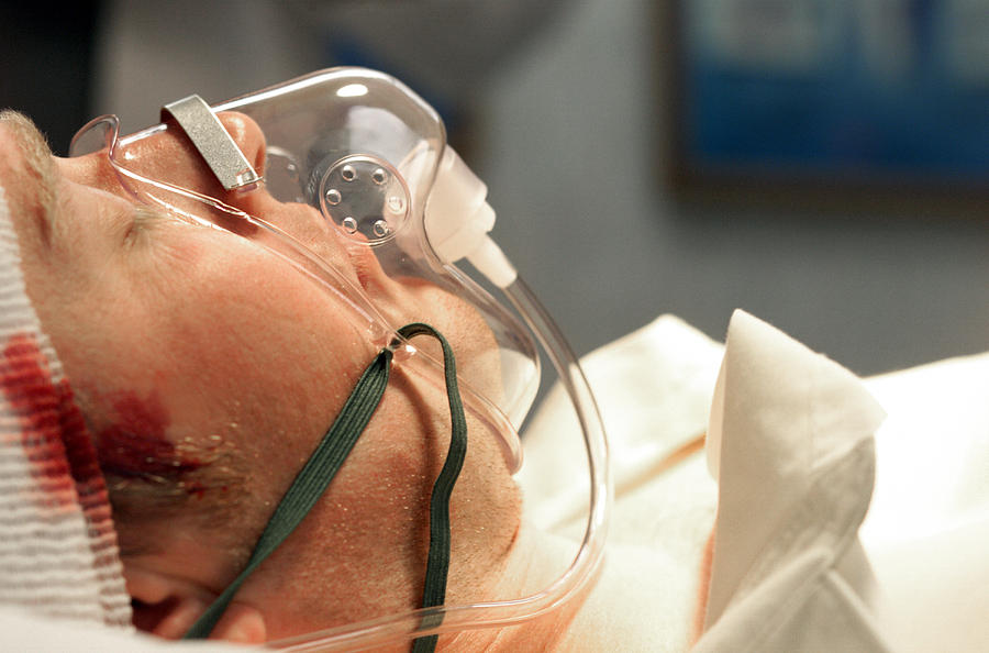 Close Up Of Caucasain Male Patient With A Head Trauma And An Oxygen Mask Photograph by Photodisc