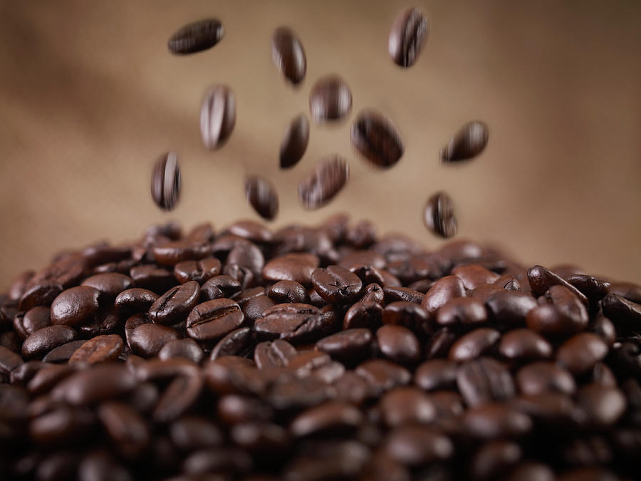 Close Up Of Coffee Beans Falling In Heap Photograph by Adam Gault
