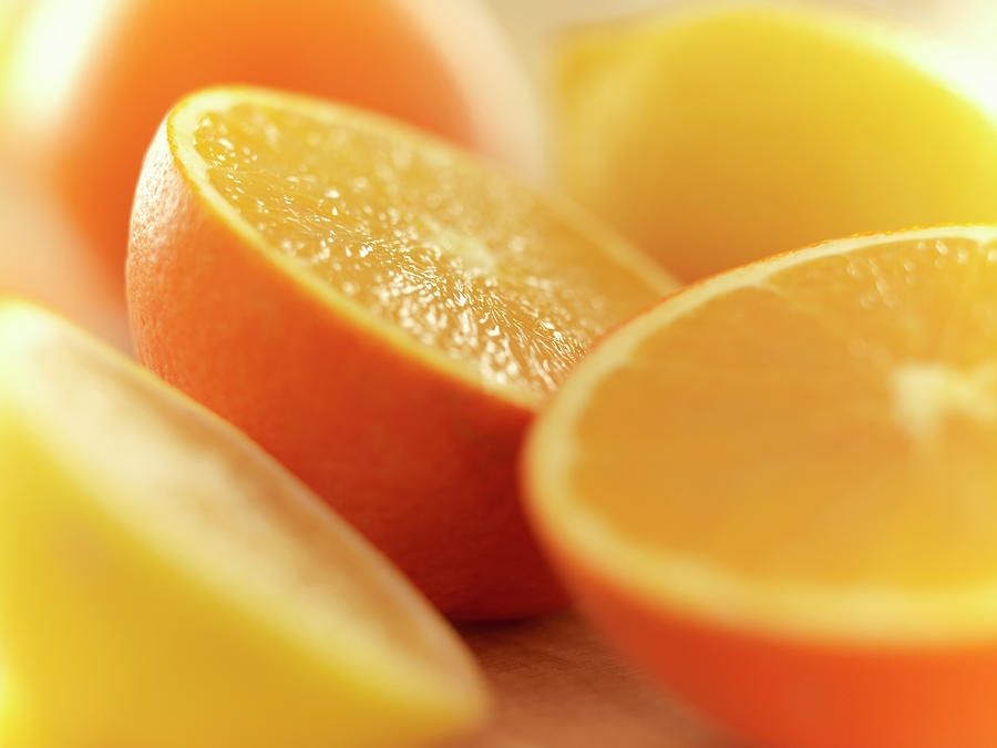 Close Up Of Cut Lemons And Oranges Photograph by Adam Gault