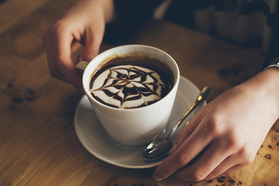 Close up of decorative coffee drink Photograph by Lumina Images