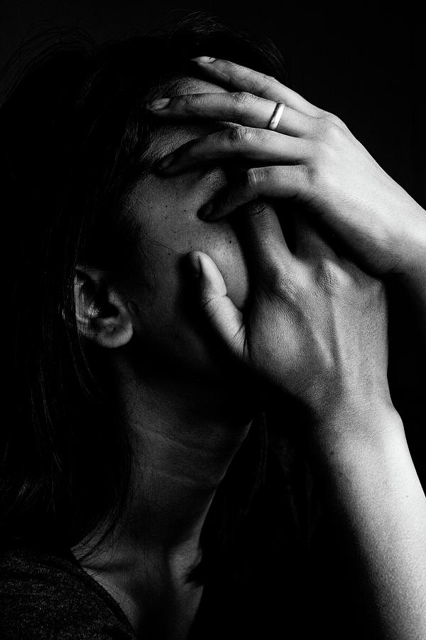 Close-up Of Depressed Woman Against Photograph by Frank Arengh / Eyeem