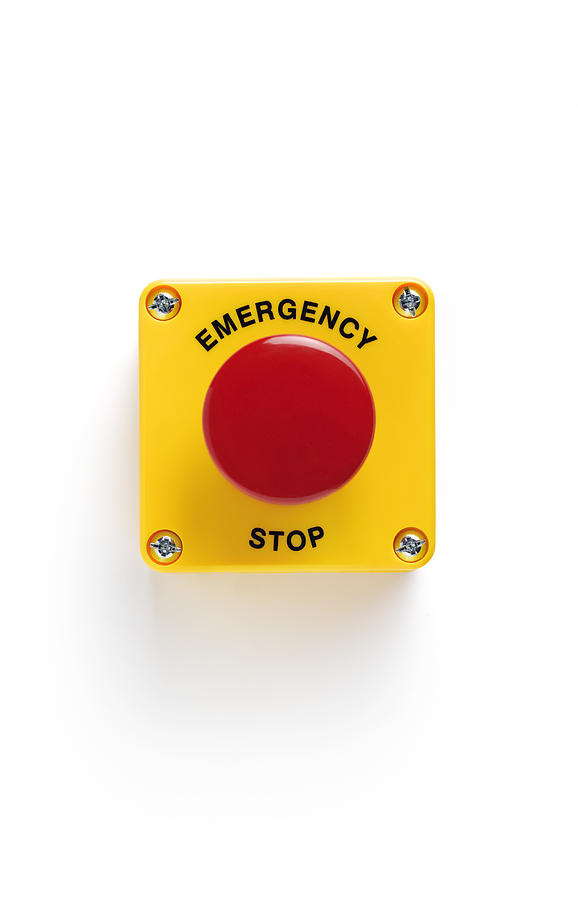 Close up of emergency stop panic button with Photograph by Peter Dazeley