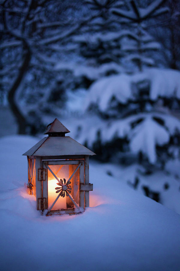 Close Up Of Glowing Lantern In Snow Photograph by Cultura Rm Exclusive/christoffer Askman