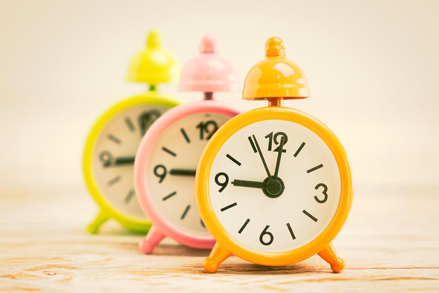 Close-up Of Multi Colored Alarm Clocks On Table by Siraphol Siricharattakul  / EyeEm