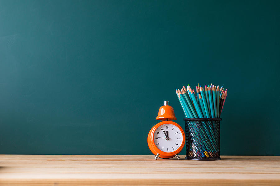 Close-up Of Pencils In Container By Alarm Clock On Table Photograph by Shih Wei Wang / EyeEm
