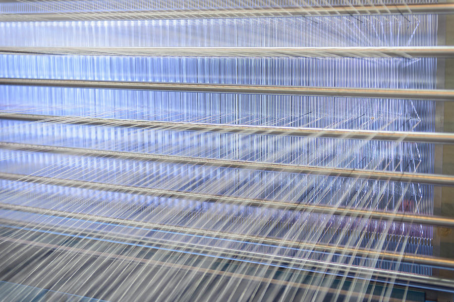 Close Up Of Threads On Industrial Loom Photograph by Monty Rakusen