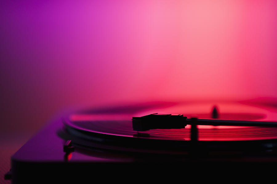 Close up of turntable on pink background Photograph by Daniel Grill