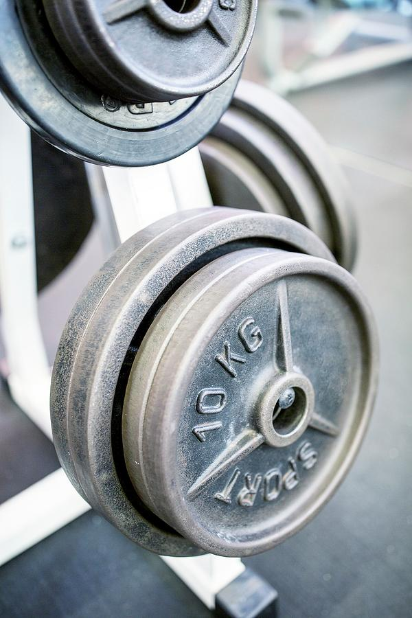Cardiovascular Exercise Photograph - Close-up Of Weight Plates by Science Photo Library