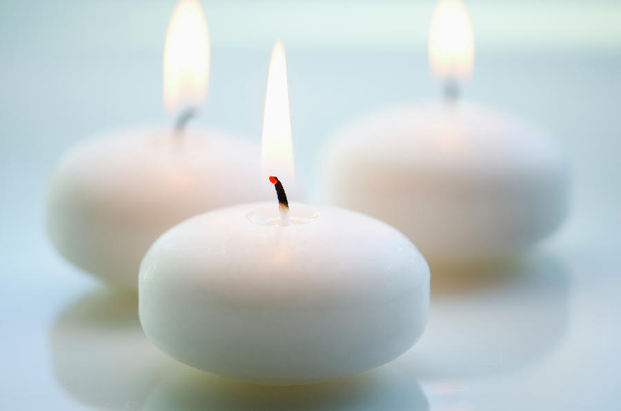 Close-up Of White Candles Photograph by Tetra Images