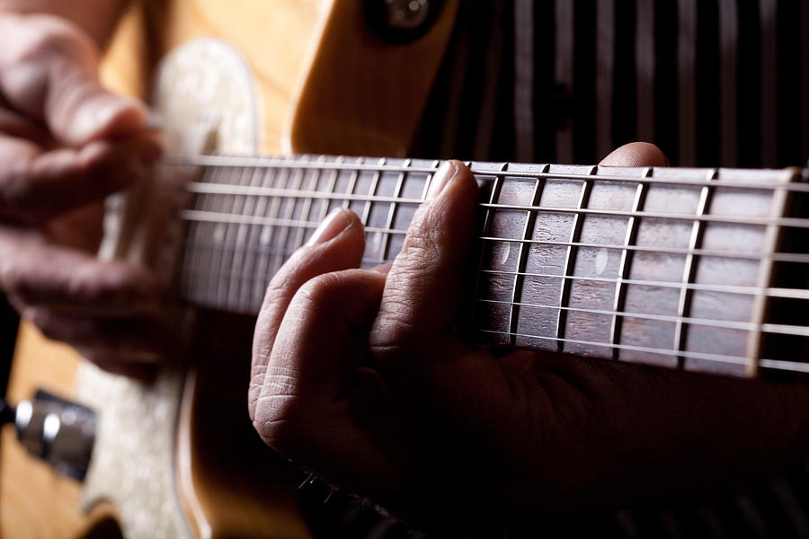 Age Photograph - Close Up Shot Of A Man Playing Guitar by Kyle Lee