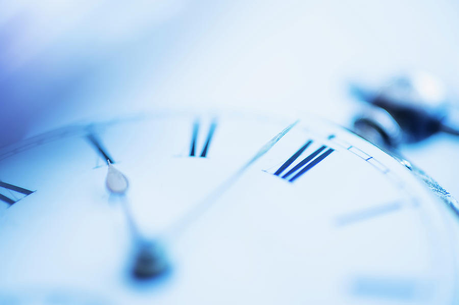 Close-up Shot Of Pocket Watch In Blue Photograph by Tetra Images