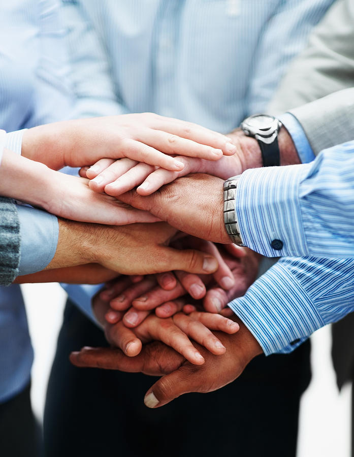 Closeup of a business people with hands together Photograph by Jacob Wackerhausen