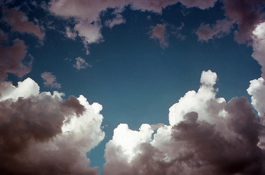 Blue Photograph - Hole in the Clouds by Jim Cotton