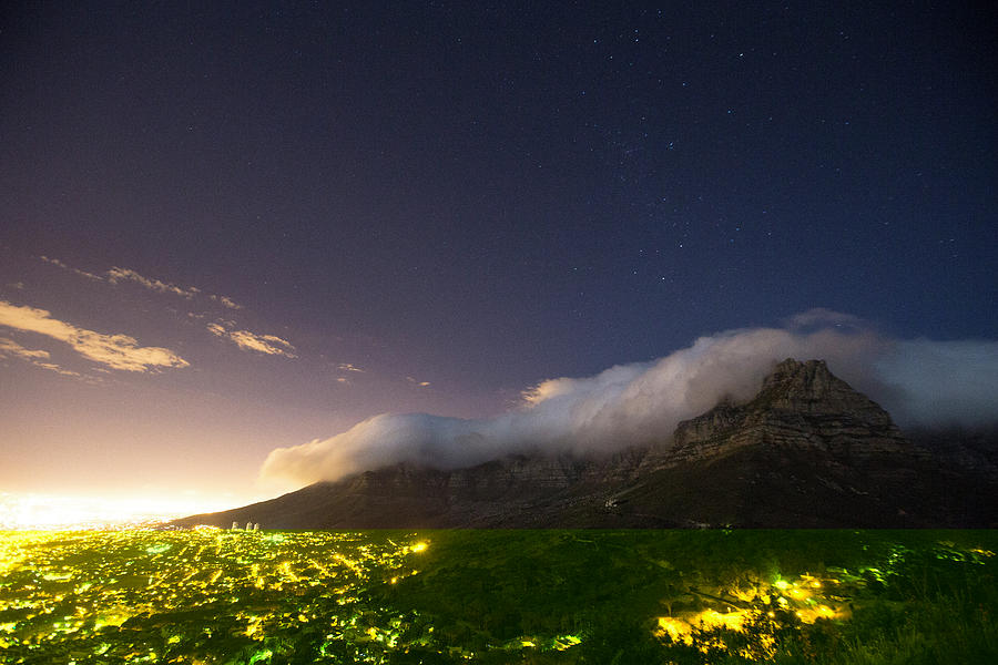 Illuminated Photograph - Clouds Loom Over Table Mountain In Cape by Matt Andrew