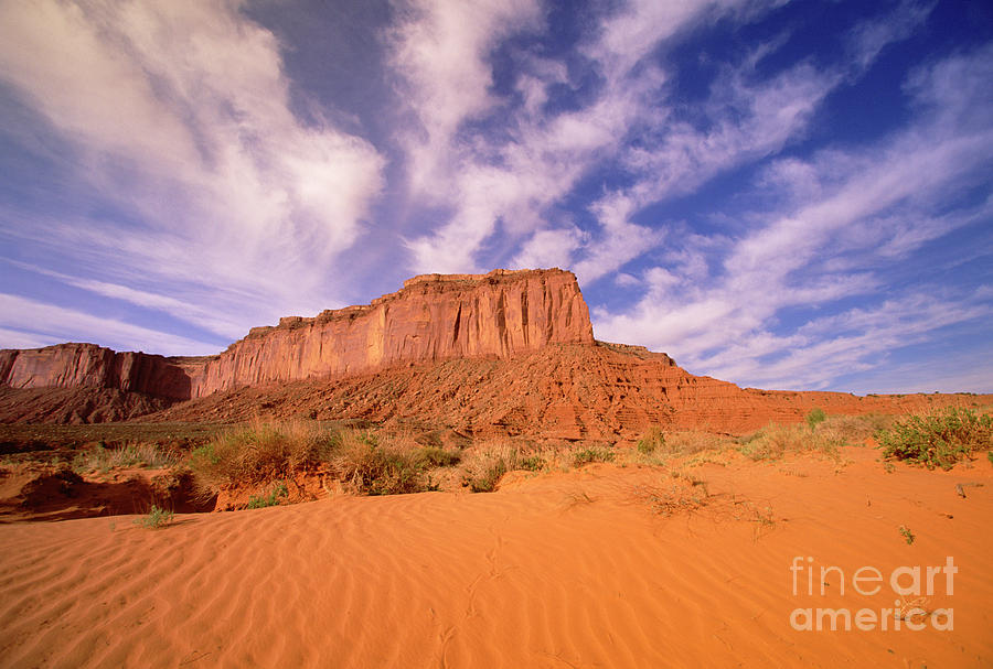 Clouds Over Monument Valley Photograph by Yva Momatiuk and John Eastcott