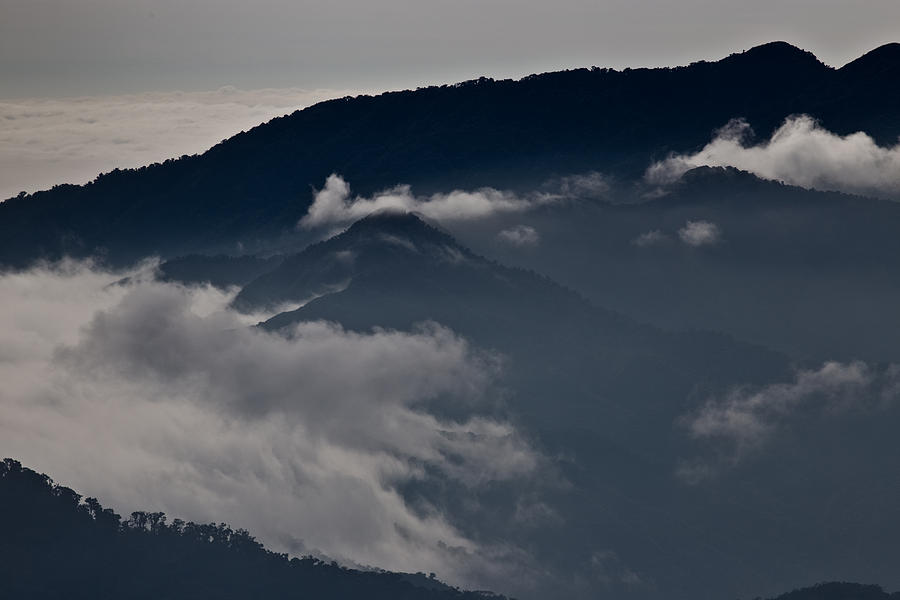 Clouds Photograph - Clouds over the mounatins by Brian Magnier