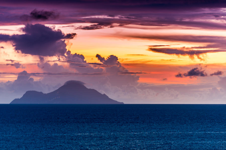 Sea Photograph - Clouds Over The Sea by Paul Johnson