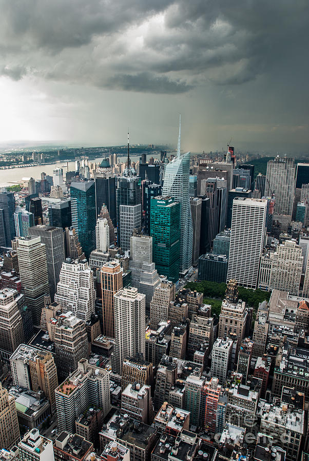 Nyc Photograph - cloudy Manhattan by Hannes Cmarits