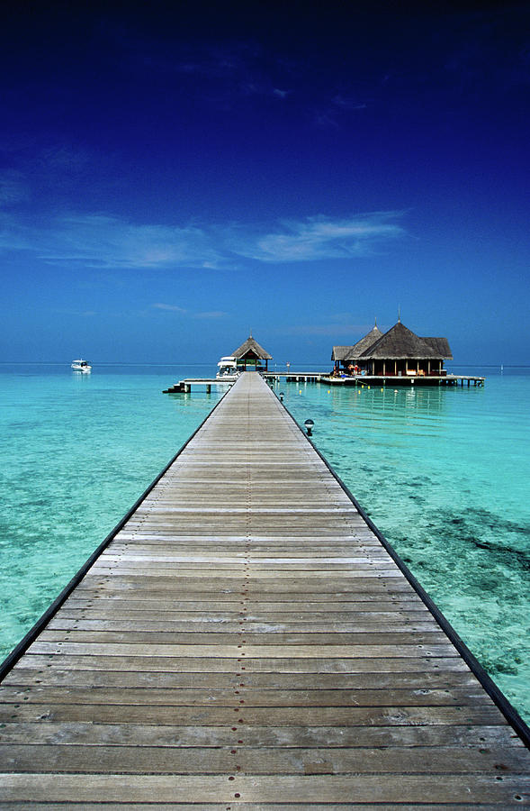 Club Med Kani, Long Pier Surrounded By Photograph by Izzet Keribar