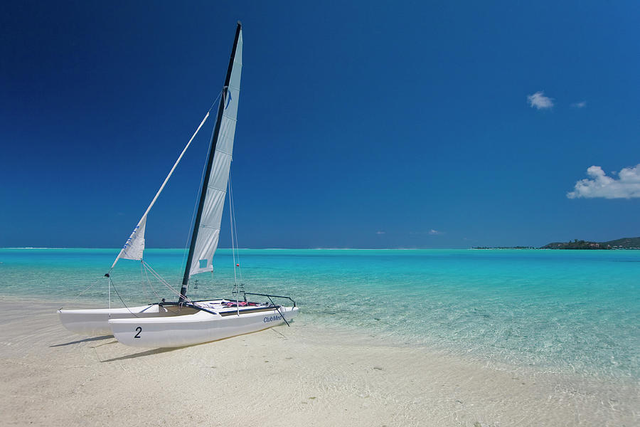 Club Med Sailing Catamaran On Shore Of Photograph by Merten Snijders