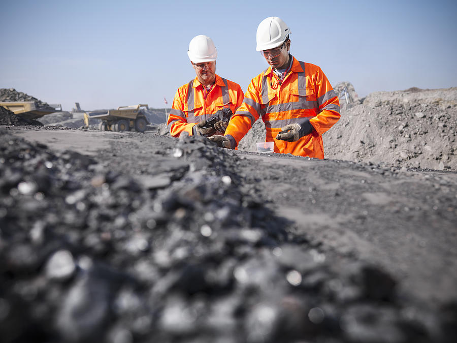Coalminers Inspecting Coal In An Opencast Colamine Photograph by Monty Rakusen