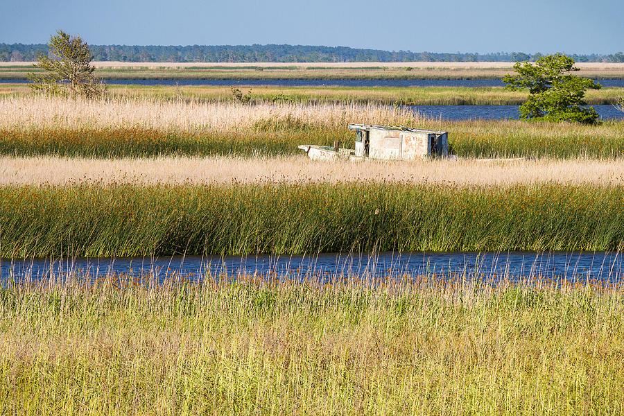 Coastal Landscape Photograph - Coastal Marshlands With Old Fishing Boat by Bill Swindaman