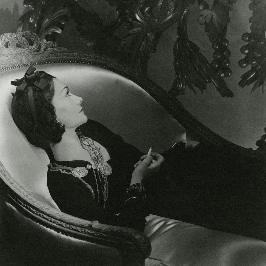 Coco Chanel On A Chaise Longue Photograph by Horst P. Horst